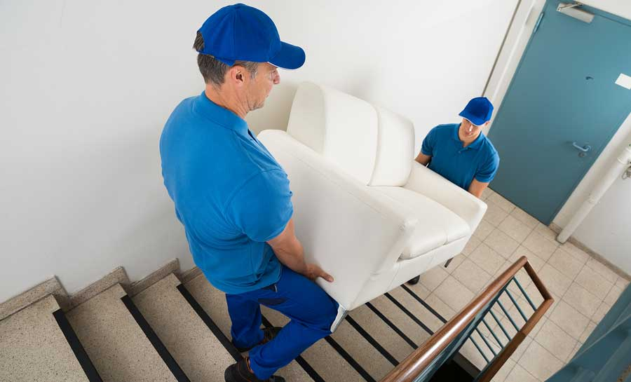 Two movers delivering sofa