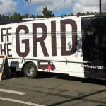 """bus with """"off the grid"""" painted on the side"""