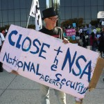 Protester with sign against NSA