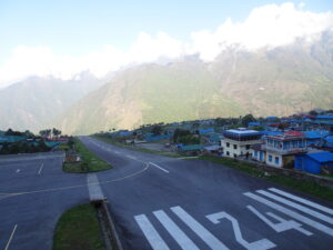 Everest Base Camp: Lukla's airport is literally on the edge of the cliff. Take off seems like dropping off an edge. Landing seems like heading into a wall.