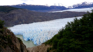 The Patagonia glacier pours out blue icebergs into the lake.