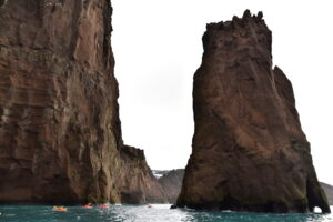 There is a rocky formation named the Needle next to the entrance to the atoll, Deception Island, in the seas surrounding Antarctica. Antarctic Kayaking