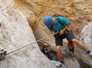 Canyoneering in Rubio Canyon: Rappelling down a slot