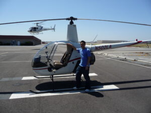 Standing next to the helicopter