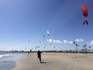 Kiteboard at Belmont Shore: many colorful kites along the shore
