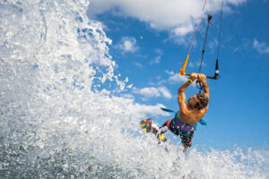Kiteboard at Belmont Shore: hold on tight as the wind lifts you out of the water