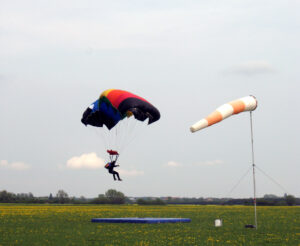 Skydiving: Skydive: Bend your knees while landing