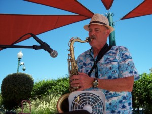 Stan playing sax on a summer gig