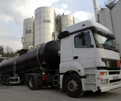 Tanker truck parked at the outside of factory