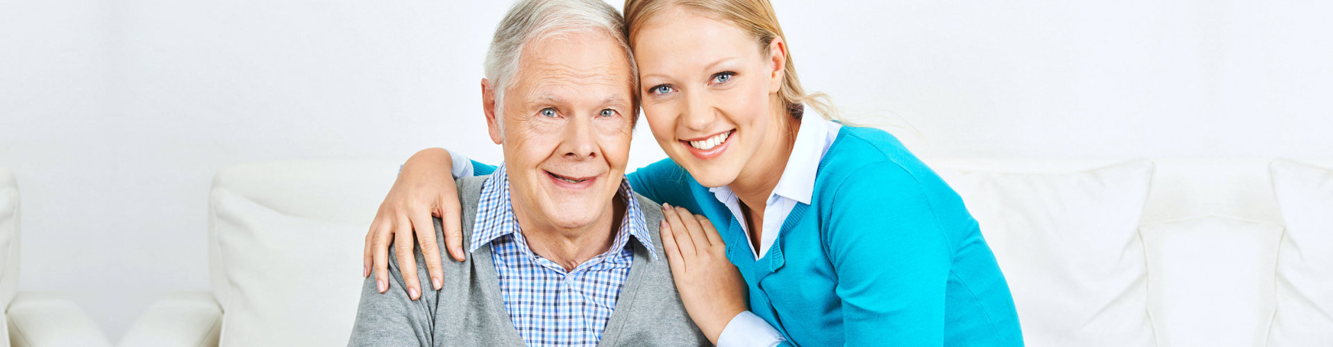 caregiver hugging her senior patient
