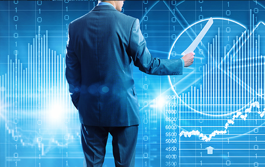 man standing in front of charts and graphs