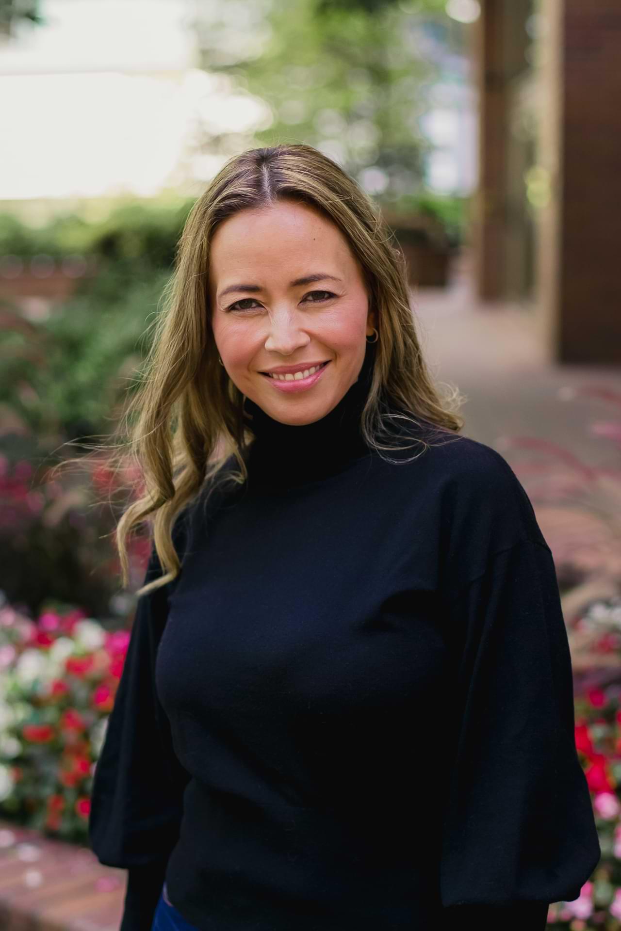 Portrait of Tara Haddad - CEO of Modern Foods Inc.