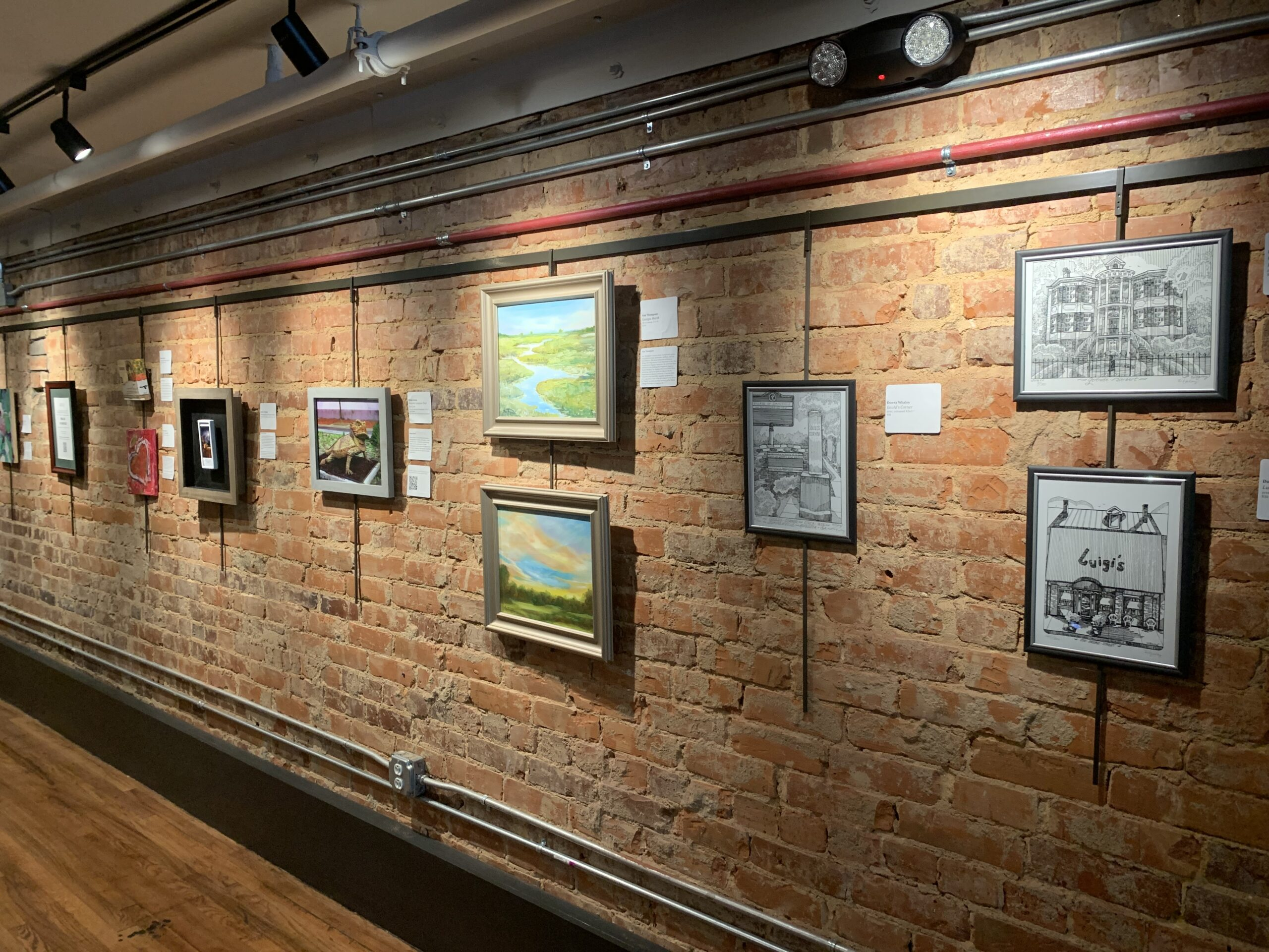 wall of submissions for public art exhibit