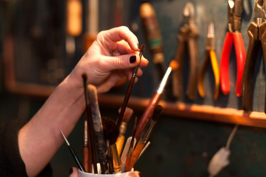 artist taking paint brush