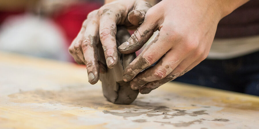 artist hands working with clay