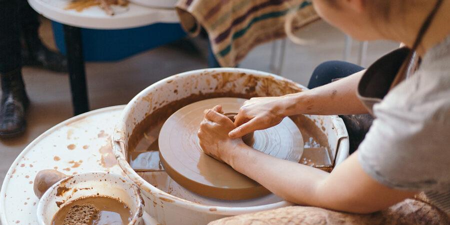 artist using pottery wheel
