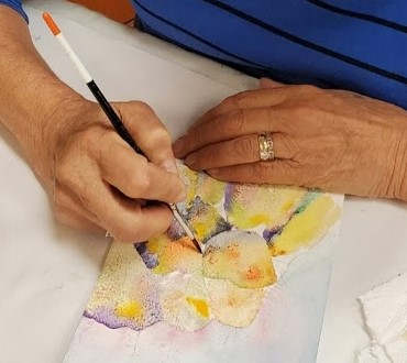 artist painting with watercolors