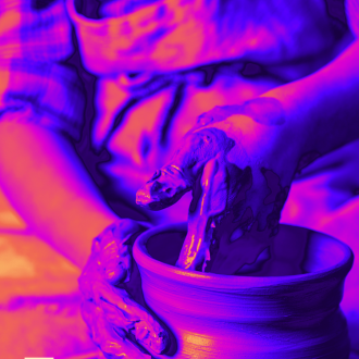 Person making clay pot