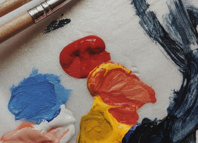 paint colors and paintbrush on canvas