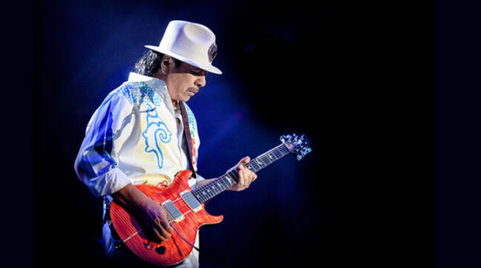 carlos santana playing the guitar
