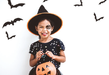child wearing a witch costume