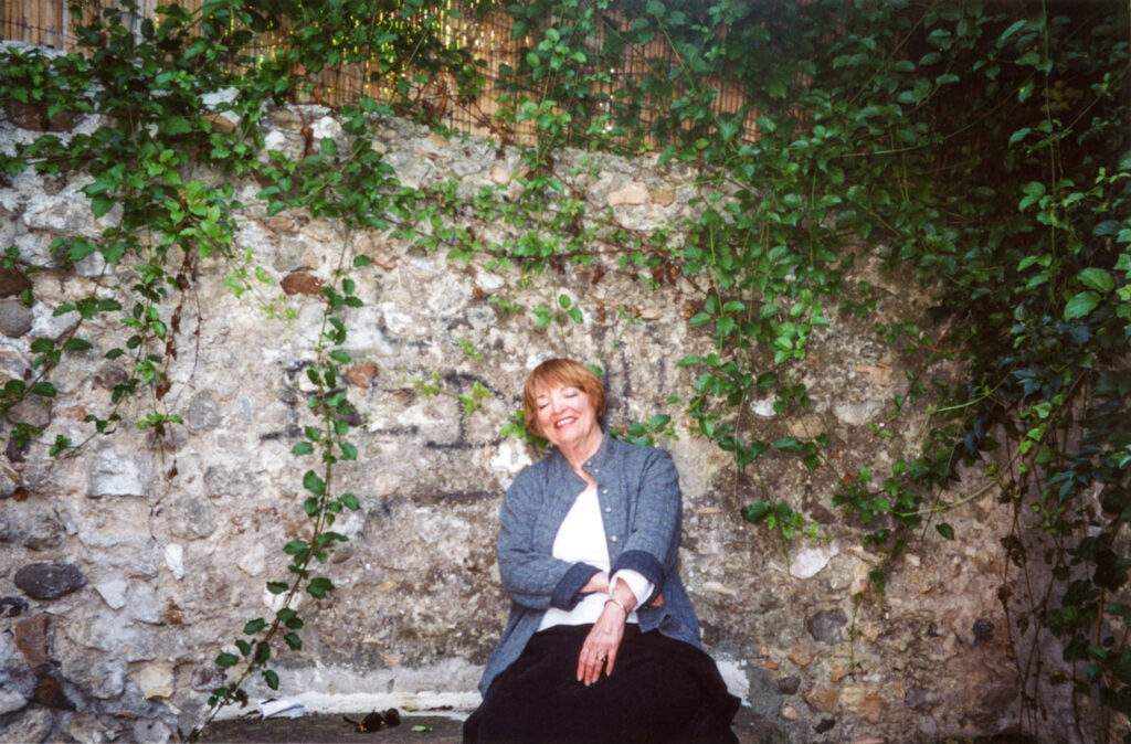 """Elaine Badgley Arnoux sitting on the """"crying bench"""" in Biot, France."""