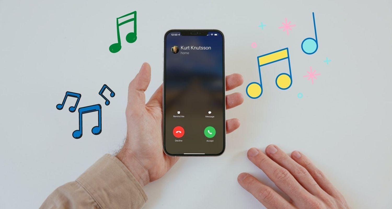 man holding phone with ringtones sounding
