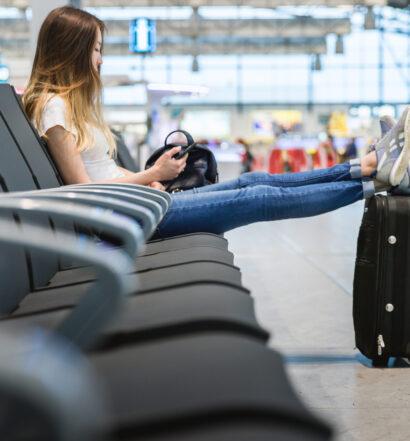 Girl Text Messaging Flight Info