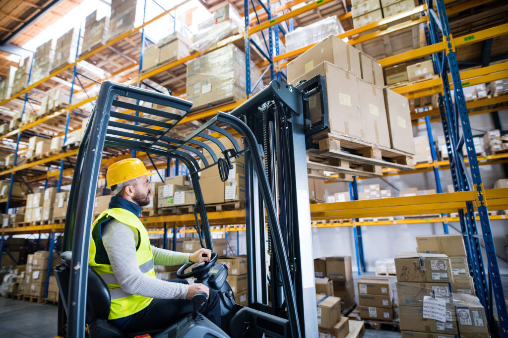 warehouse-man-worker-with-forklift-PFBRL671