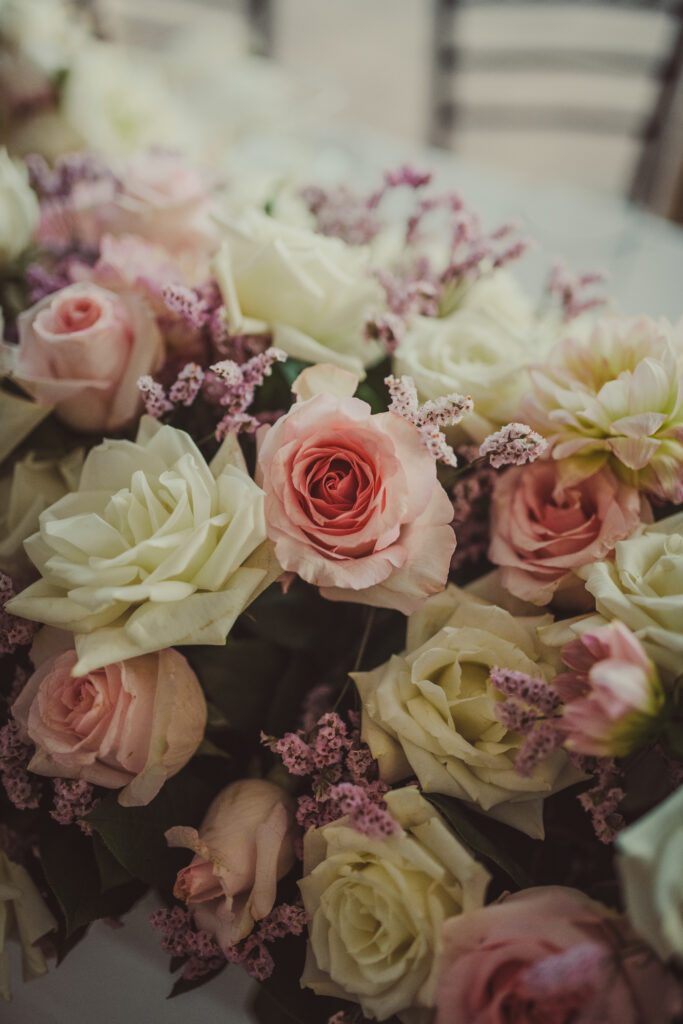 Sweetheart table rose arrangement with white and pink roses