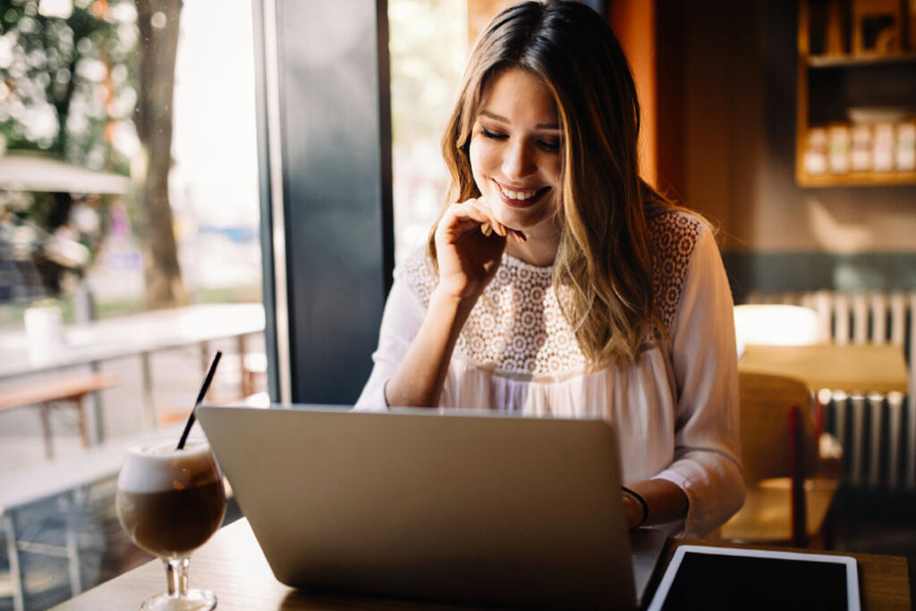 Young woman doing exam prep online for real estate school class