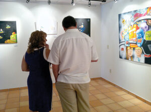 Patrons step back to take in the whole picture at the Libertad de la Imaginacion opening reception. Photo: Cayetano Garza Jr./LFN