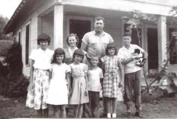 Early Wenke family gathering in La Feria home - Backrow: Georgene, Sally, Carl, and Karl; Front row: Geneva, Vivian, Butch, Clara.