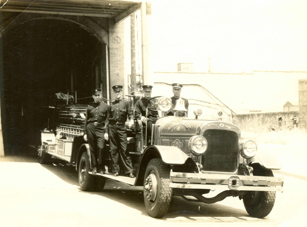 Sadly no photographs remain of Henry L. Buchman or the La Feria Volunteer Fire Department circa 1932, however this photo of Austin, Texas Fire Department Truck Co. 1 ca.1935 at Old Central Fire Station #1 gives us a good idea of the uniforms and firetruck of firefighters in La Feria at that time. Photo: www.austinfiremuseum.org