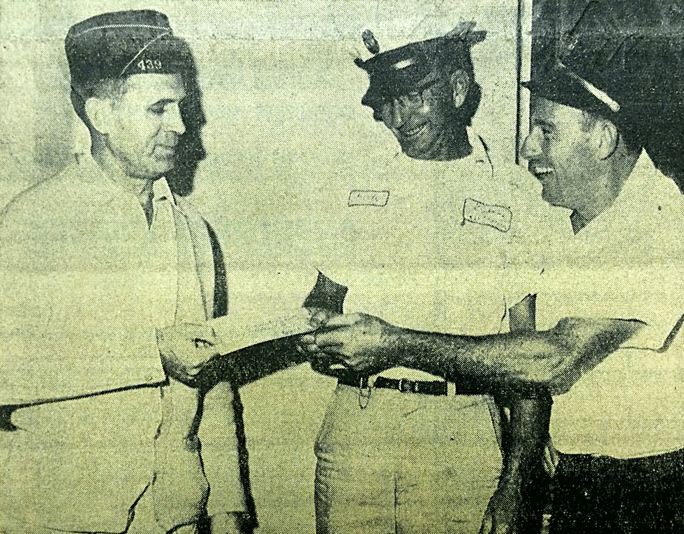 """This photo originally ran in the Thursday, November 17, 1960 issue of  LA FERIA NEWS, a week after the announcement of the purchase of a fifth fire truck for the Volunteer Fire Deparment of La Feria. The caption read, """"Just what we needed - Members of the La Feria Volunteer Fire Department happily accept a $350 check from the American Legion to be used in buying equipment for the new fire truck now on order. Shown left to right are Morris Traylor of Post 439 of the American Legion presenting the check to Fire Chief Curly Davis, center, and C.J. Carter, immediate past Fire Chief who helped inaugurate the project of securing a new fire truck."""""""