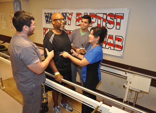 Charles Reginald Coats, a Navy veteran, receives intensive rehabilitation for an injury at the Inpatient Rehabilitation Unit at Valley Baptist Medical Center in Harlingen. Assisting Mr. Coats, from the left, are Elijah Gonzalez, physical therapy assistant; Marty Villarreal, DPT, Physical Therapist; and Dacia Veloz, RN, BSN, nurse with the Inpatient Rehab Unit.