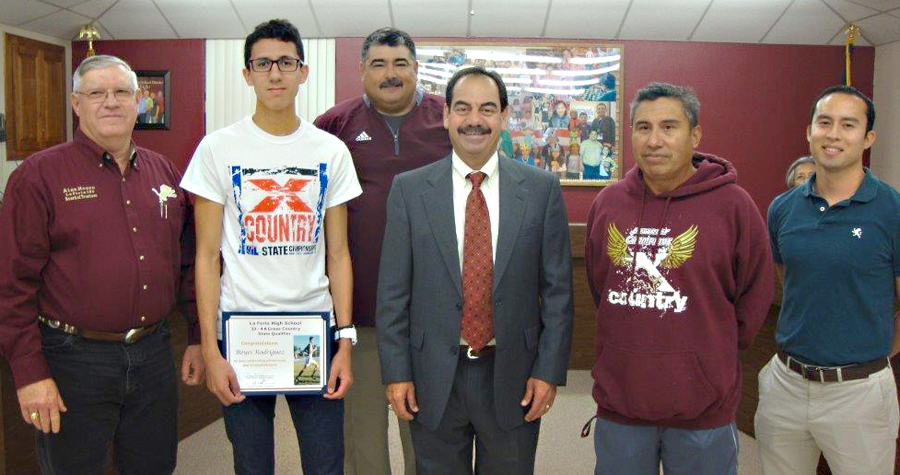 Rey Villarreal and the La Feria ISD School Board recognize our La Feria High School Varsity Boys' Cross Country Team Member who qualified for the state meet, Reyes Rodriguez.