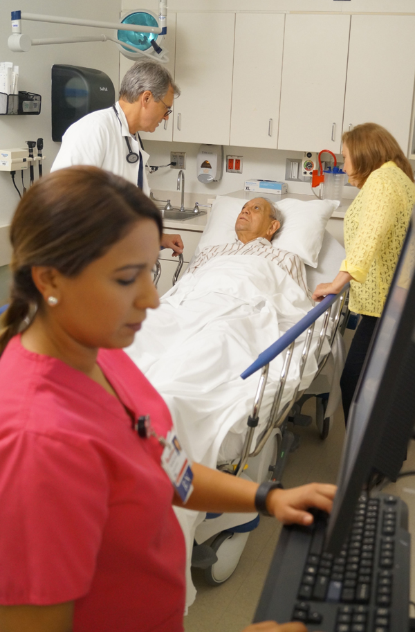 Dr. Michael Mohun, Medical Director for Emergency Services at Harlingen Medical Center, checks on a patient in the hospital's award-winning Emergency Room.