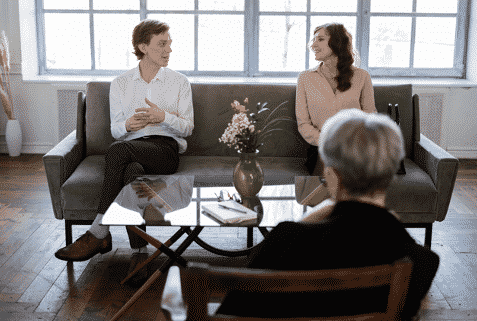 A couple meeting with a counselor
