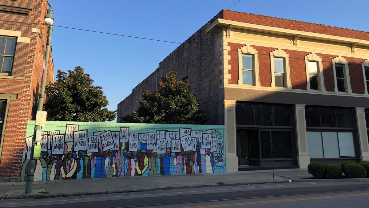 "View of the mural ""I Am A Man"" by Marcellous Lovelace (installed by BLK75) on South Main Street, Memphis, Tennessee, under the waning light. (Photo by Ben Young Landis)"