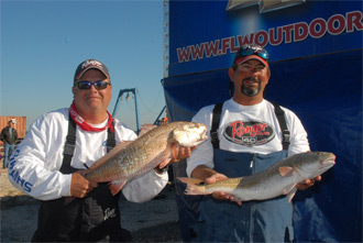 Two-time Redfish Series winners Ray Chagnard (left) and Edward Adams – both of Metairie, La. – are just an ounce off the lead with two redfish for 17 pounds, 10 ounces. (Photo by Rob Newell)