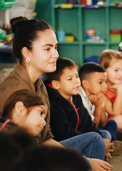 Teacher in classroom with small children