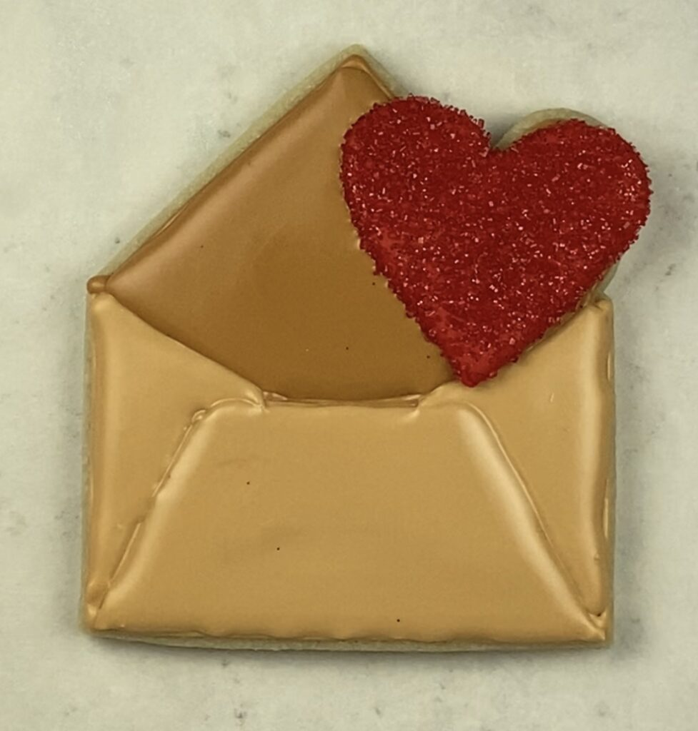 fill bottom portion of envelope with royal icing