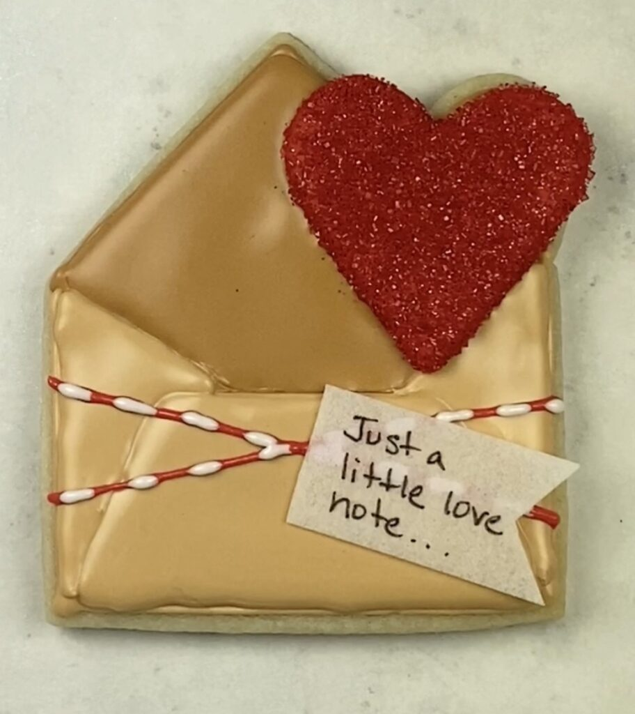 Attach wafer paper note to wet icing