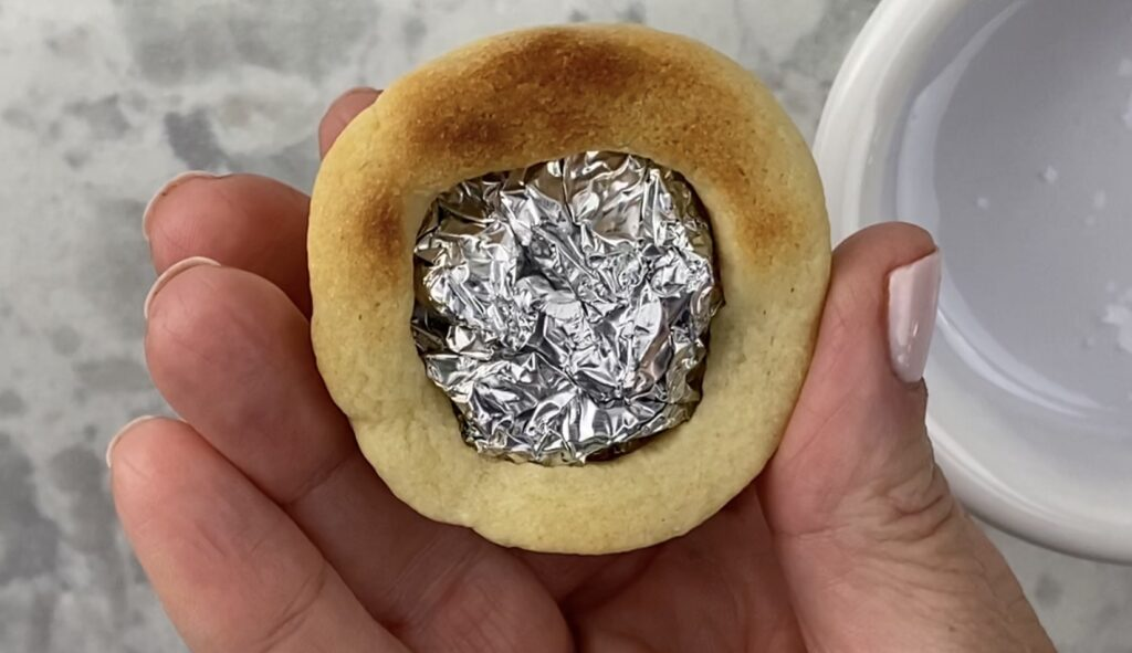 Underside of cookie showing the foil ball to create the rounded shape