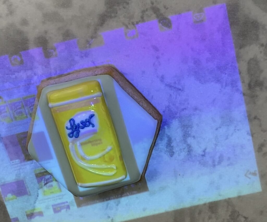 Lysol disinfectant wipe jar projected on cookie
