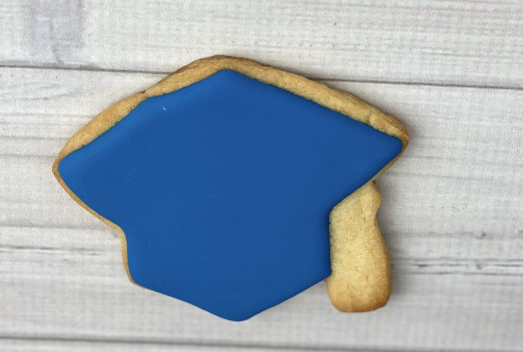 Outline and flood mortar board cookies for 2020 Graduation Cookies