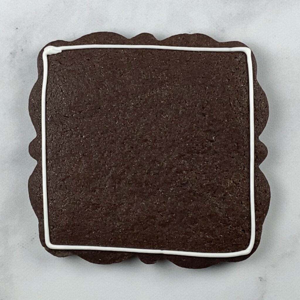 Large plaque cookie outlined
