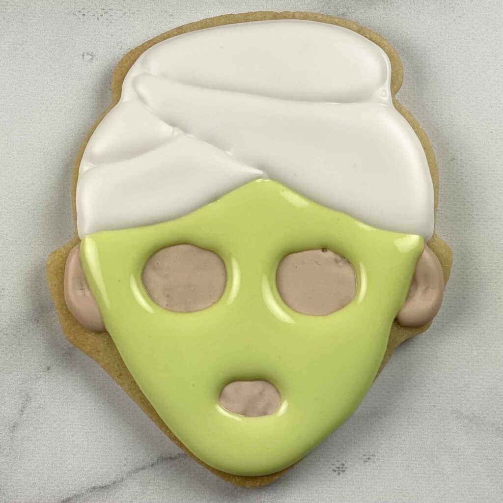 Pipe face mask with green icing