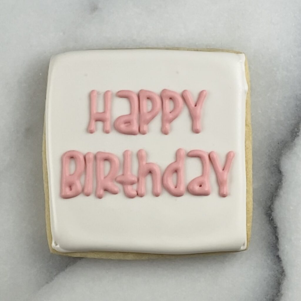 Pipe saying on birthday cookie